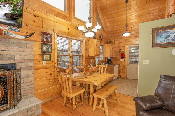 Dining table in the living area at Alpine Romance, a 2 bedroom cabin rental located in Pigeon Forge