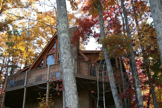 view of log cabin named alpine romance a 2 bedroom cabin rental located in pigeon forge in the fall season