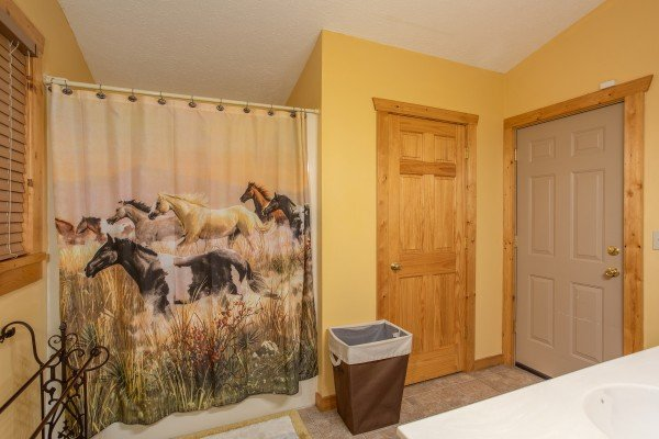 Bathroom with a tub and shower at Alpine Romance, a 2 bedroom cabin rental located in Pigeon Forge