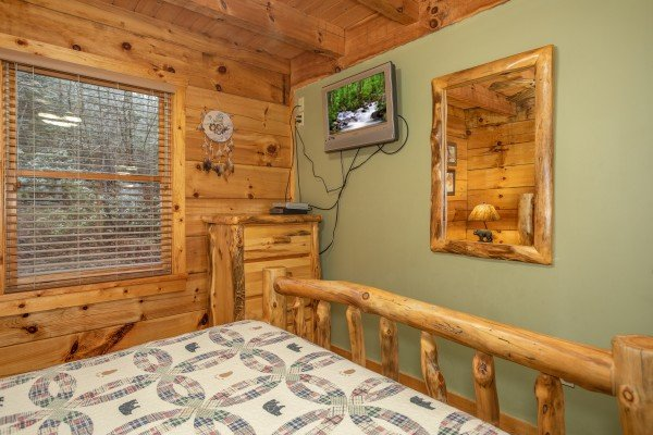 Queen bedroom with a dresser and TV at Alpine Romance, a 2 bedroom cabin rental located in Pigeon Forge