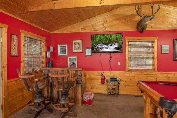 Dry bar, TV, and pool table in the loft space at Alpine Romance, a 2 bedroom cabin rental located in Pigeon Forge