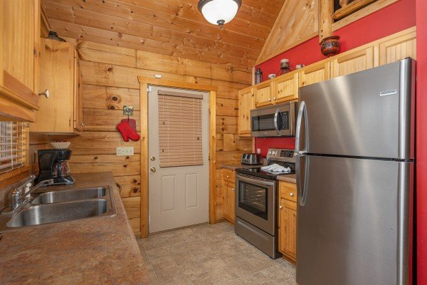 Kitchen with stainless appliances at Alpine Romance, a 2 bedroom cabin rental located in Pigeon Forge