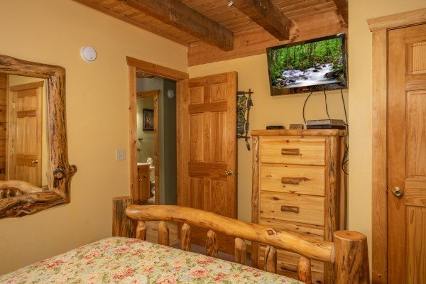 Bedroom with a dresser and TV at Alpine Romance, a 2 bedroom cabin rental located in Pigeon Forge