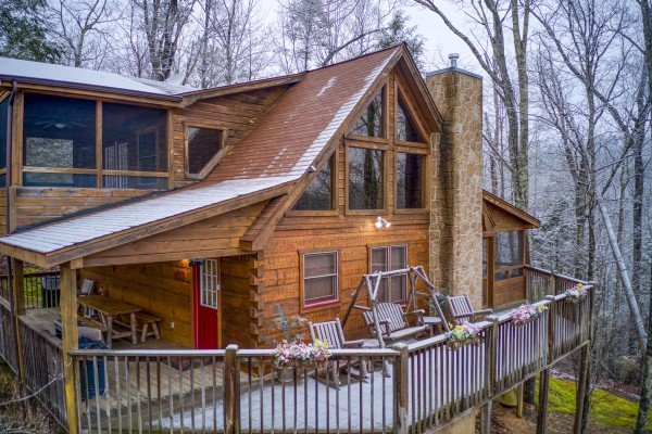 Alpine Romance, a 2 bedroom cabin rental located in Pigeon Forge with a dusting of snow