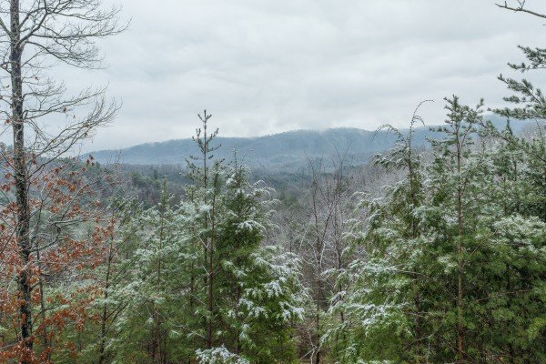 Snowy mountain views at Alpine Romance, a 2 bedroom cabin rental located in Pigeon Forge