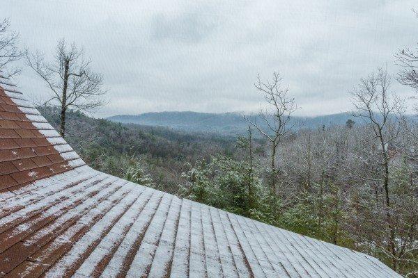 A dusting of snow and the Smoky Mountains at Alpine Romance, a 2 bedroom cabin rental located in Pigeon Forge