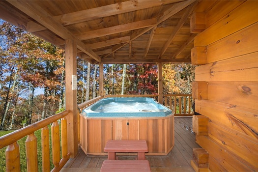 covered deck with hot tub at paws n' claws a 2 bedroom cabin rental located in gatlinburg