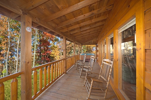 Deck with rockers at Paws n' Claws, a 2 bedroom cabin rental located in Gatlinburg