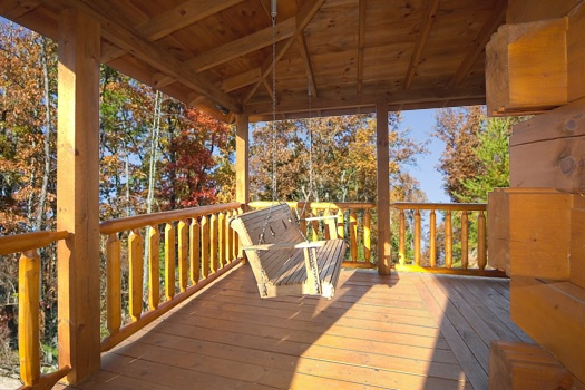 Deck with swing at Paws n' Claws, a 2 bedroom cabin rental located in Gatlinburg