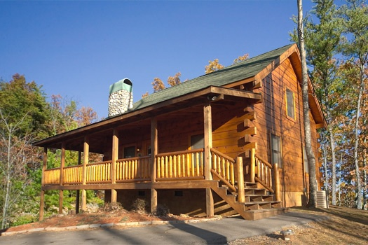 exterior view with parking area at paws n' claws a 2 bedroom cabin rental located in gatlinburg