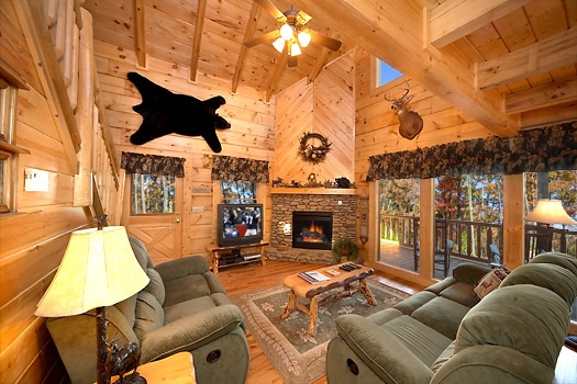 living room with fireplace at paws n' claws a 2 bedroom cabin rental located in gatlinburg
