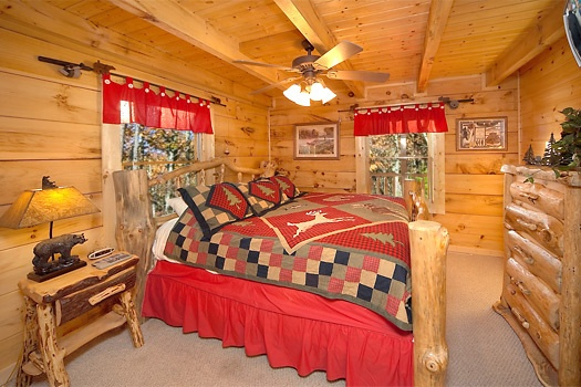 main level king bedroom at paws n' claws a 2 bedroom cabin rental located in gatlinburg