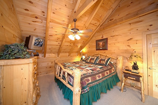 second floor bedroom with king size bed at paws n' claws a 2 bedroom cabin rental located in gatlinburg