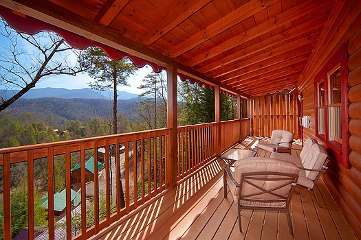 Cushioned patio furniture on the deck at Highlander, a 4 bedroom cabin rental located in Gatlinburg
