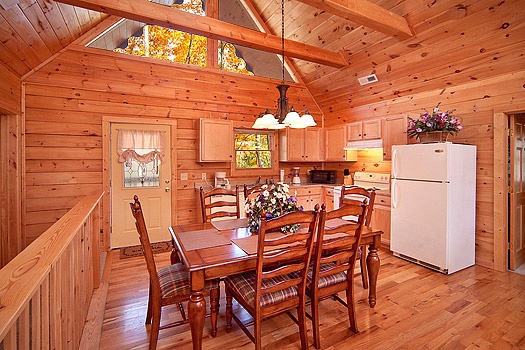 Dining table for six at Highlander, a 4 bedroom cabin rental located in Gatlinburg
