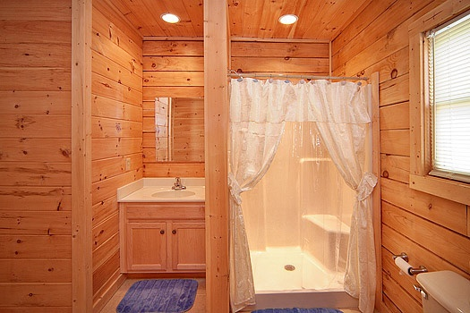 Vanity and shower in a main level bathroom at Highlander, a 4 bedroom cabin rental located in Gatlinburg