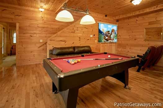 Red felted pool table in the game room at Highlander, a 4 bedroom cabin rental located in Gatlinburg