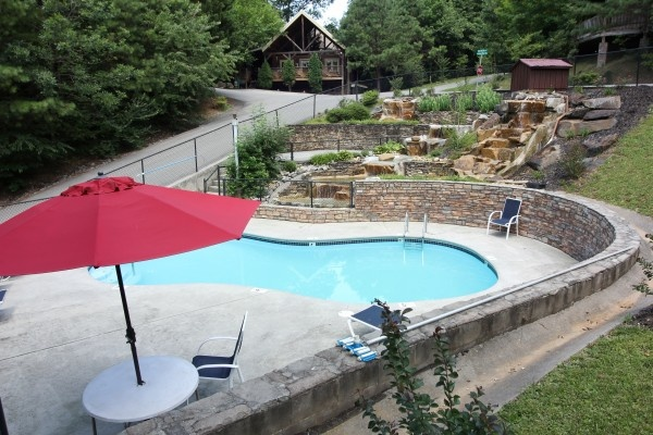 Enjoy the resort pool while staying at Highlander, a 4 bedroom cabin rental located in Gatlinburg
