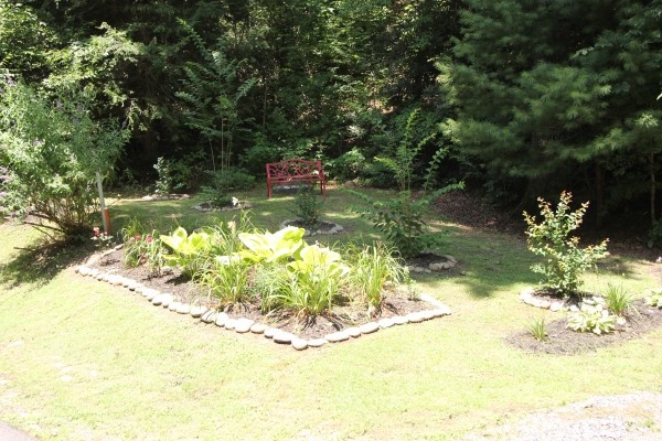 Shaded garden landscaping at the resort where you'll find Highlander, a 4 bedroom cabin rental located in Gatlinburg