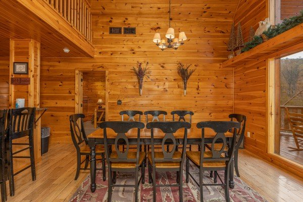 Dining table for 8 at Rainbow's End, a 4 bedroom cabin rental located in Pigeon Forge