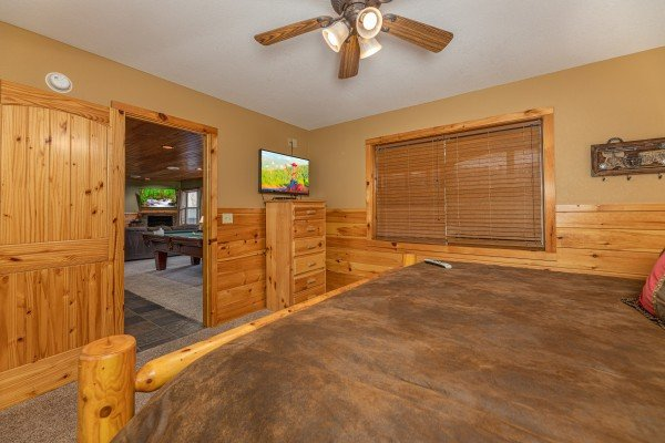 Dresser and TV in a bedroom at Rainbow's End, a 4 bedroom cabin rental located in Pigeon Forge