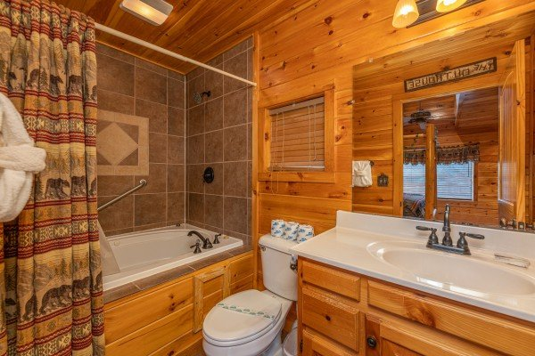 Bathroom with a jacuzzi and shower at Rainbow's End, a 4 bedroom cabin rental located in Pigeon Forge