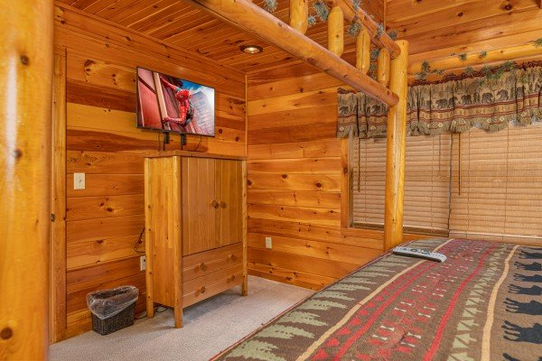 Armoire and TV in a bedroom at Rainbow's End, a 4 bedroom cabin rental located in Pigeon Forge
