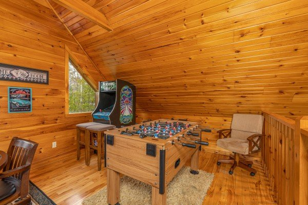 Foosball and arcade game in the loft at Rainbow's End, a 4 bedroom cabin rental located in Pigeon Forge