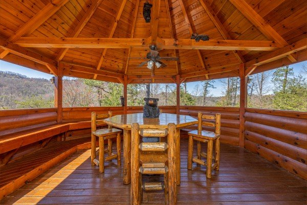 Table and chairs in the gazebo on the deck at Rainbow's End, a 4 bedroom cabin rental located in Pigeon Forge