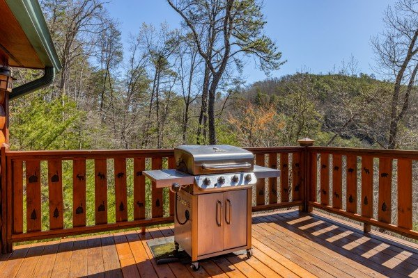 Grill on the deck at Rainbow's End, a 4 bedroom cabin rental located in Pigeon Forge