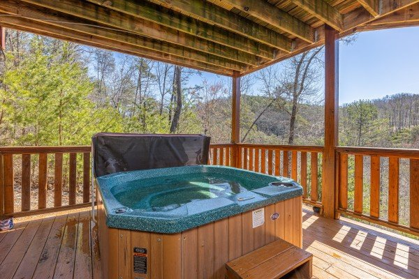 Hot tub on the lower deck at Rainbow's End, a 4 bedroom cabin rental located in Pigeon Forge