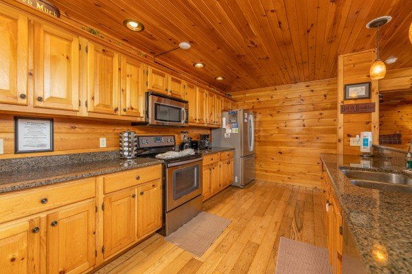 Kitchen with stainless appliances at Rainbow's End, a 4 bedroom cabin rental located in Pigeon Forge