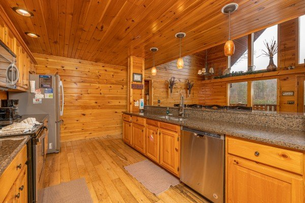 Kitchen island with stainless appliances at Rainbow's End, a 4 bedroom cabin rental located in Pigeon Forge