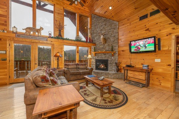 Living room with fireplace and TV at Rainbow's End, a 4 bedroom cabin rental located in Pigeon Forge
