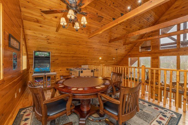 Poker table in the loft at Rainbow's End, a 4 bedroom cabin rental located in Pigeon Forge