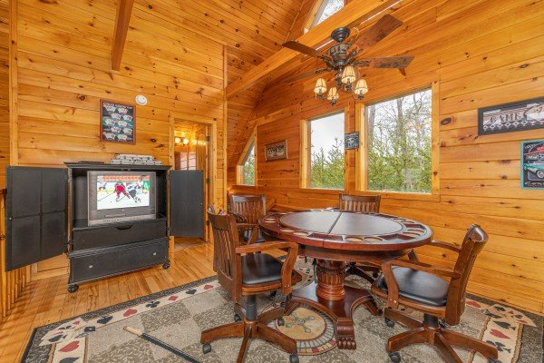 TV and poker table in the loft at Rainbow's End, a 4 bedroom cabin rental located in Pigeon Forge
