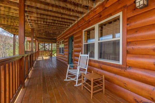 Rocking chair on the lower porch at Rainbow's End, a 4 bedroom cabin rental located in Pigeon Forge
