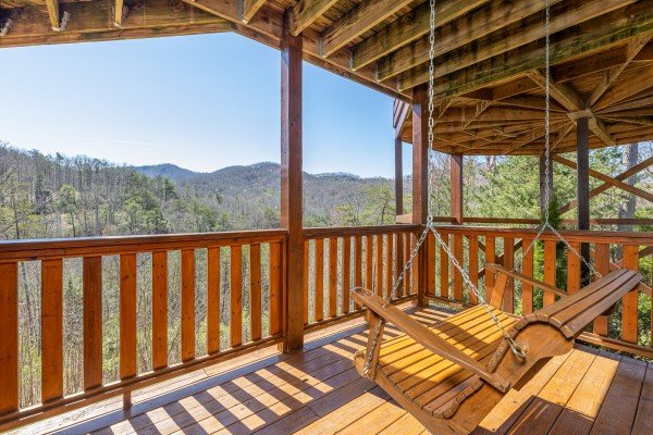 Porch swing at Rainbow's End, a 4 bedroom cabin rental located in Pigeon Forge