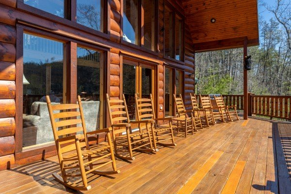 Rocking chairs on a deck at Rainbow's End, a 4 bedroom cabin rental located in Pigeon Forge