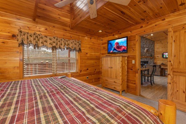 Armoire & tv in a bedroom at Rainbow's End, a 4 bedroom cabin rental located in Pigeon Forge