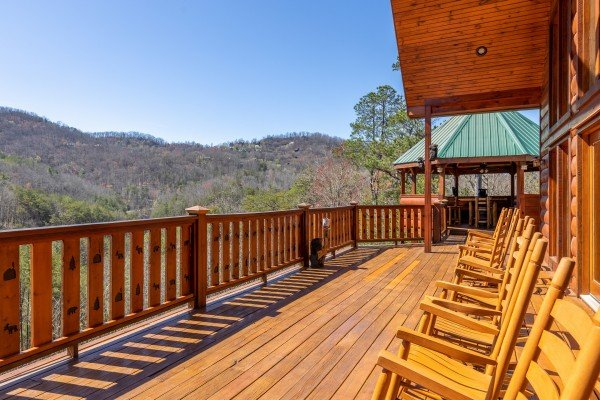 Rocking chairs and a mountain view from the deck at Rainbow's End, a 4 bedroom cabin rental located in Pigeon Forge