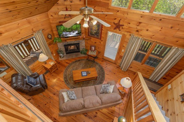 Looking down into the living room at Hillside Haven, a 1 bedroom cabin rental located in Pigeon Forge
