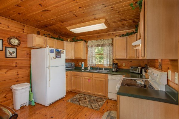 Kitchen with white appliances at Hillside Haven, a 1 bedroom cabin rental located in Pigeon Forge