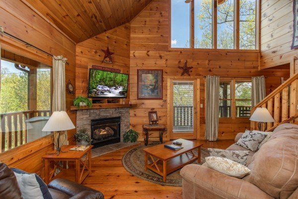 Living room with fireplace and TV at Hillside Haven, a 1 bedroom cabin rental located in Pigeon Forge