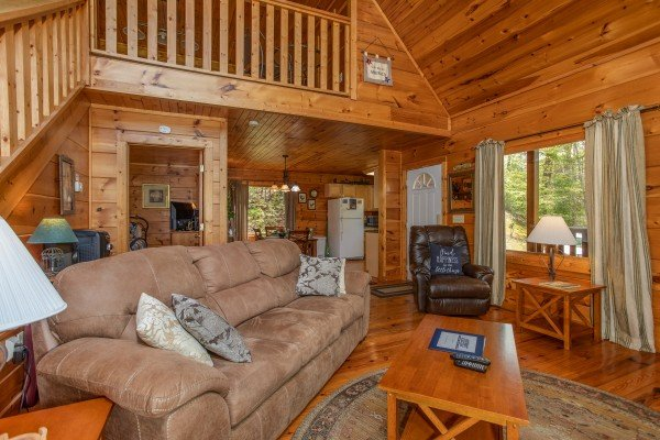 Living room and kitchen at Hillside Haven, a 1 bedroom cabin rental located in Pigeon Forge
