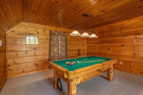 Pool table in the loft at Hillside Haven, a 1 bedroom cabin rental located in Pigeon Forge