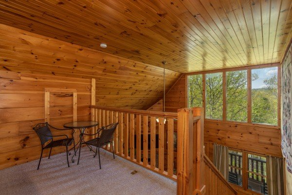 Bistro set in the loft at Hillside Haven, a 1 bedroom cabin rental located in Pigeon Forge