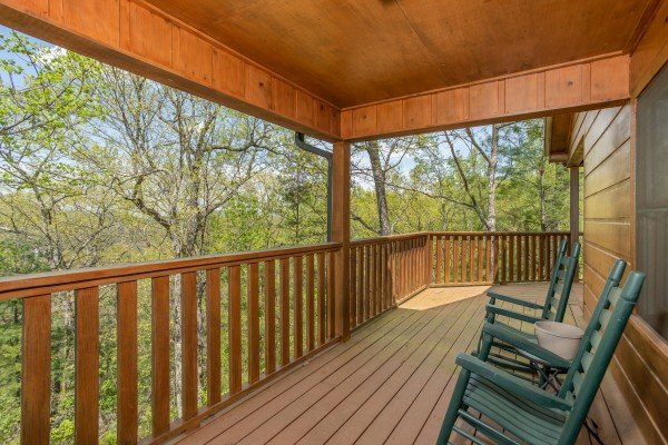 Rocking chairs on the covered porch at Hillside Haven, a 1 bedroom cabin rental located in Pigeon Forge