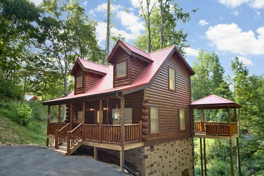 Two story log cabin named Brownie Bear, a 1-bedroom cabin rental located in Gatlinburg