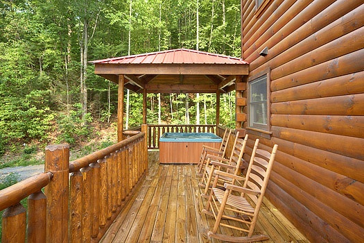deck with chairs and hot tub under gazebo at brownie bear a 1 bedroom cabin rental located in gatlinburg
